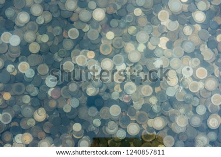 Coins in a Wishing Well #1240857811