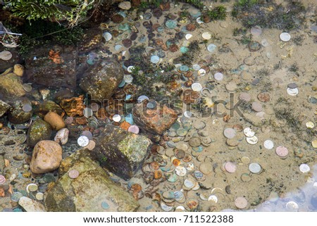 Coins in a wishing well #711522388