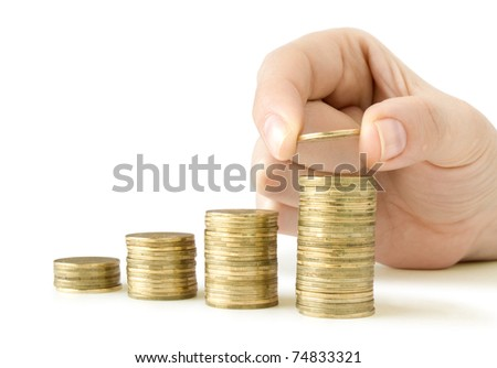 coins in finger and row stacks them isolated on white