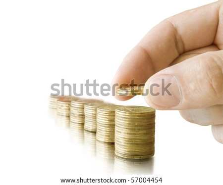 coins in the hand and reflection