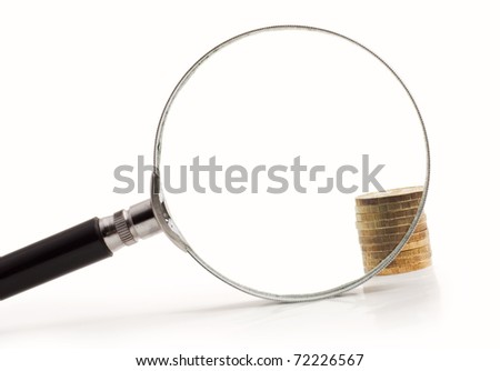 coins increased magnifying glass isolated on white background