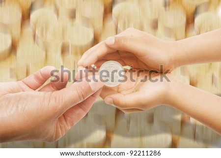 coins into hands of another person