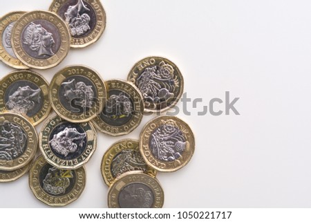 Photo of Coins isolated on white background, UK currency