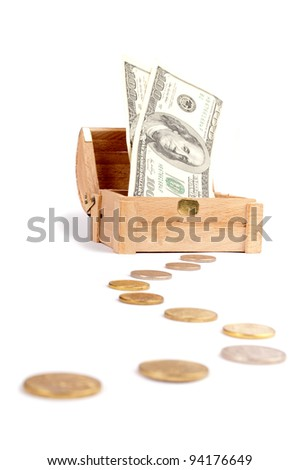 Coins like path and wooden treasure chest with dollar-bills isolated on white