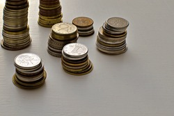 coins of different countries and denominations on painted table