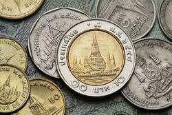 Coins of Thailand. Wat Arun Temple in Bangkok, Thailand, depicted in the Thai ten baht coin.