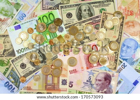 Coins on paper bills as background. Background from dollars and euro bills.