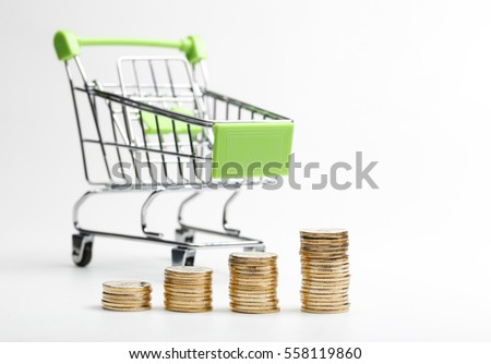 COINS pile and shopping cart on a white background  #558119860