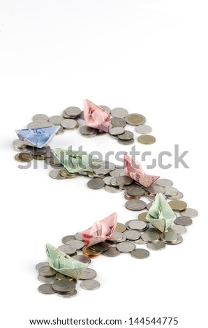 Coins put into the water for Thailand banknote folded as a boat path financially.