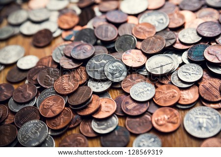 Coins. Quarters, pennies and nickels.  Financial concept