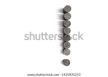 Coins stacked in stacks in the form of an exclamation mark. #1425835253