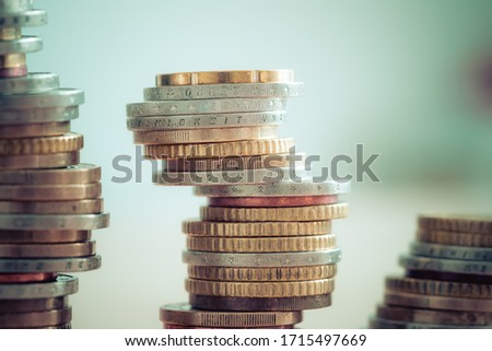 Coins stacked on each other, close up picture, market crisis and fragile market Foto stock ©