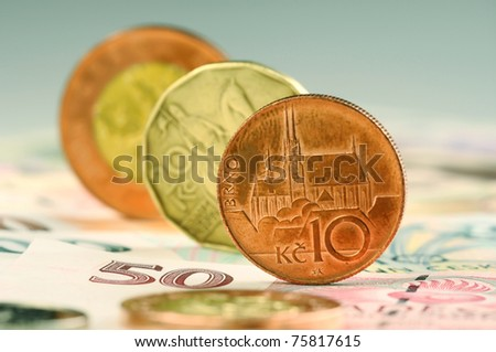 Coins standing on their edges of amount ten, twenty and fifty