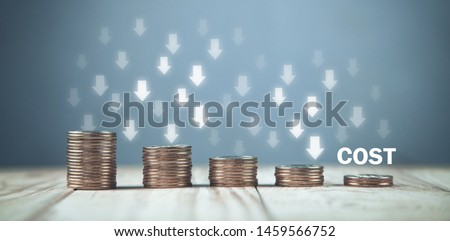 Coins with a Cost text and down arrows. Сток-фото ©