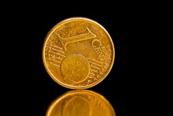 coins with a small denomination of one Euro cent are used on the territory of the European Union, cash coins are not isolated, closeup of real cash European money