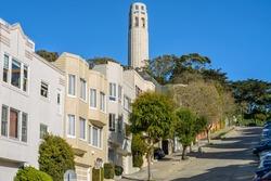 Coit Tower - A close-up view of Coit Tower in Telegraph Hill neighborhood, as seen from steep Filbert Street, San Francisco, California, USA.
