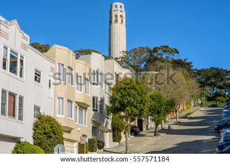 Coit Tower - A close-up view of Coit Tower in Telegraph Hill neighborhood, as seen from steep Filbert Street, San Francisco, California, USA.
