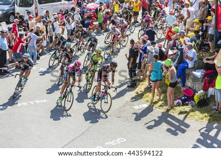 COL DU GLANDON, FRANCE - JUL 23:The peloton riding on the road to Col du Glandon during the stage 18 of Le Tour de France on July 23, 2015 #443594122