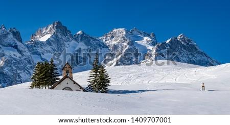 Col du Lautaret, Hautes-Alpes La Meije, Alps, France: Panoramic winter view on the Ecrins National Park glaciers with La Chappelle des Fusillés