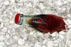 Cola bottle in crushed ice