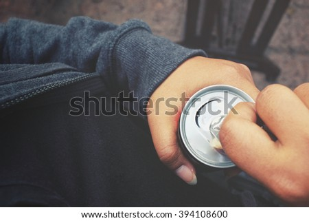 Cola can and hand #394108600