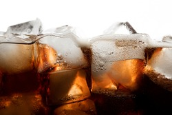 Cola soda with ice bubble in glass on white background cold drink beverage