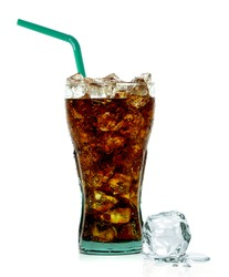 Cola with crushed ice and straw in glass on white background