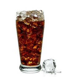 Cola with crushed ice in glass on white background