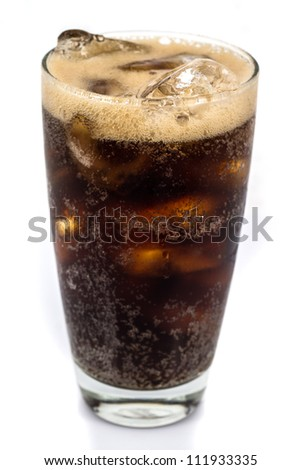 cola with ice on the grass