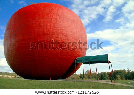 COLBORNE - OCTOBER 8: The red apple installation at the Red Big Apple pie factory on October 8, 2012 in Colborne, Ontario. The Big Apple has a height of 10.7 meters and a diameter of 11.6 meters.
