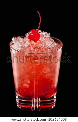 Cold alcoholic cocktail on the black background