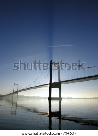 Cold and Blue by the Bridge - stock photo