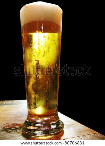 Cold and fresh beer isolated in black