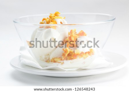 cold and fresh ice cream on transparent dish and white background