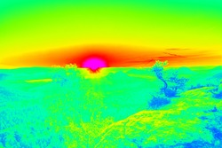 Cold and warmth in landscape, heat from sun rays absorbing. Infrared thermovision image showing thermal radiation. Abstract infrared scan.