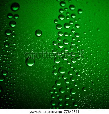 cold beer background. Misted glass of classic green bottle, macro shot.