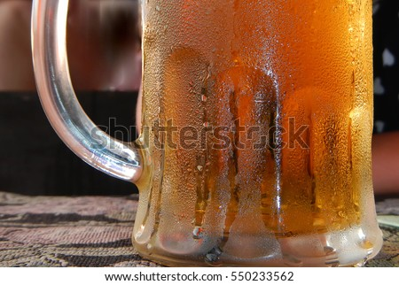 Cold beer mug with handle on table                                #550233562