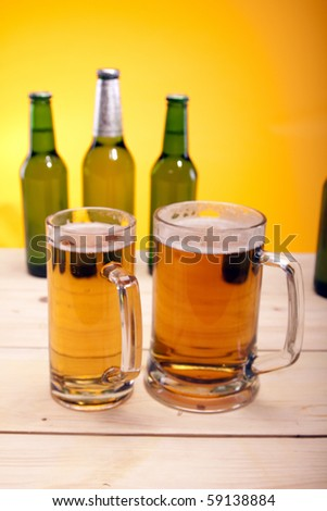 Cold beer on wooden floor  on yellow background