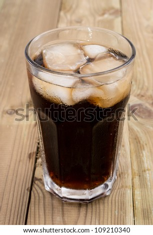 Cold Beverage with ice on wooden background