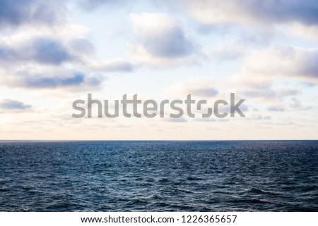 Cold blue Baltic sea under the colorful evening clouds. Winter sunset. Paldiski, Estonia #1226365657