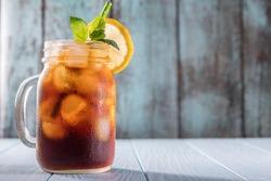 Cold brew coffee or black tea in a mason jar