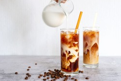 cold brew coffee with milk in tall glasses