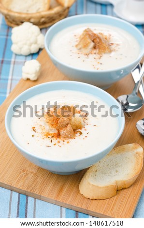cold cauliflower soup with cottage cheese and croutons, top view