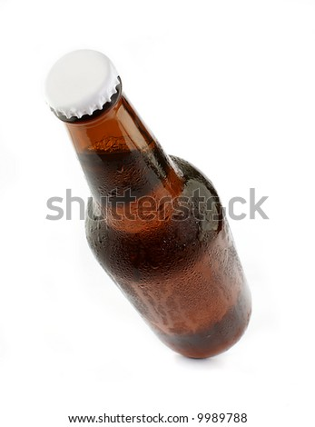 Cold chilled beer in brown bottle on a white background