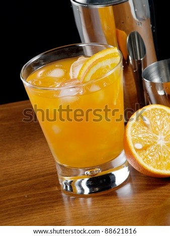 Cold cocktail with orange