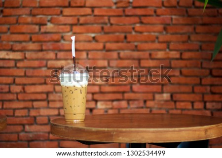 Cold coffee placed on a wooden table #1302534499