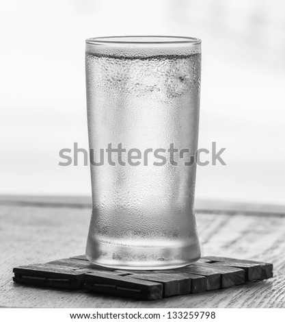 Cold drinking water in glass with water droplet