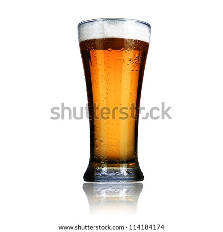 Cold glass of light beer isolated on a white background.