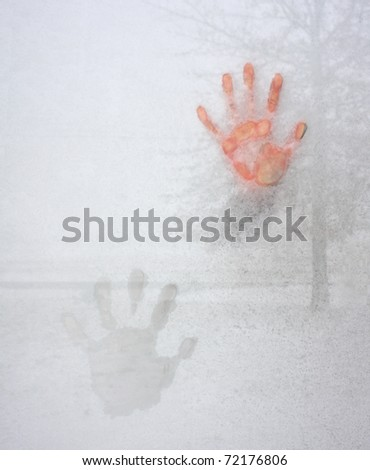 Cold Hand on Icy Window