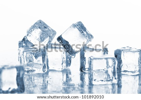 Cold ice cubes with water drops - stock photo